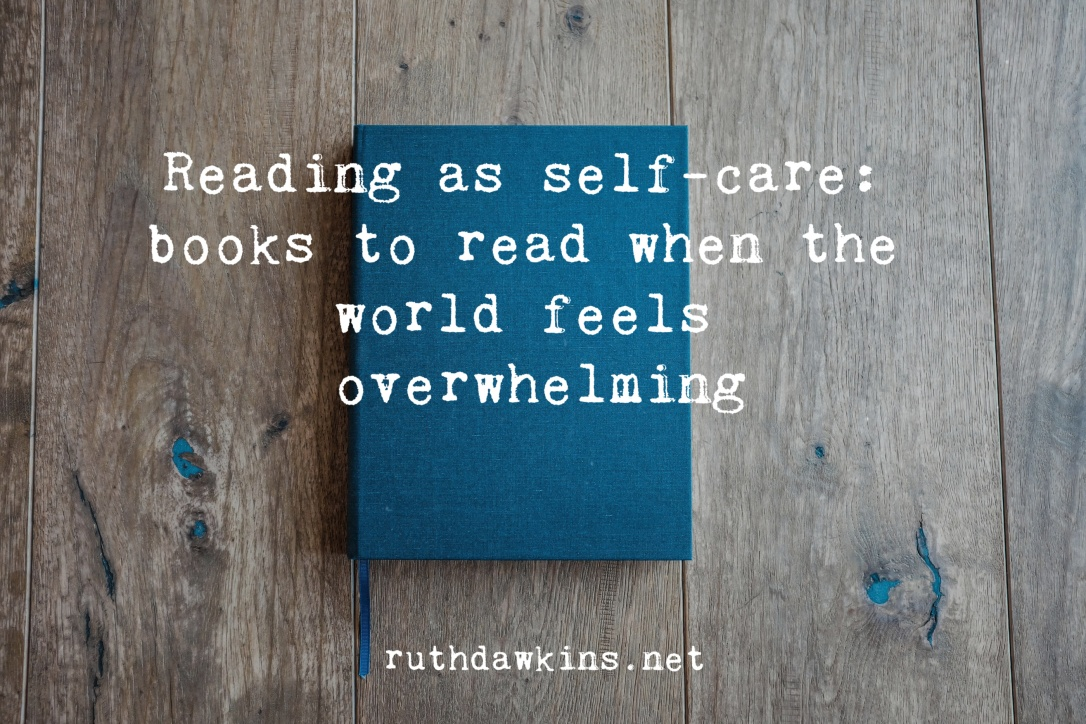a blue book on wooden table with the text 'reading as self-care: what to read when the world feels overwhelming'