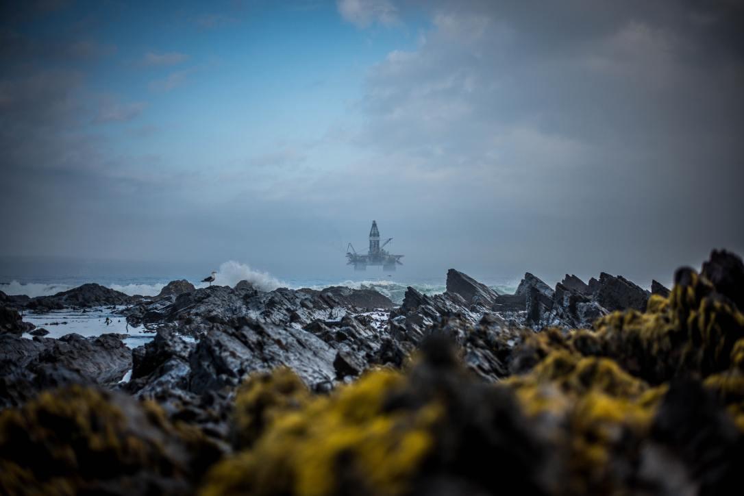 An offshore oil platform seen from shore
